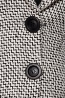 Black and white coat button